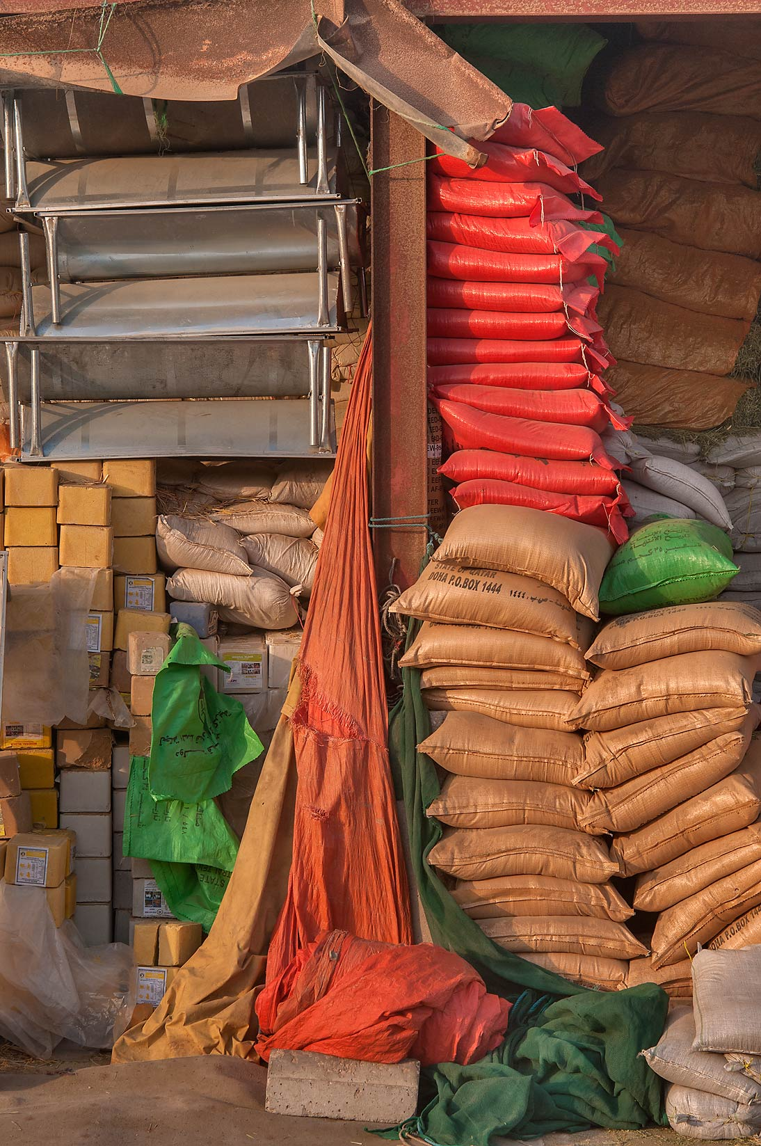 Bags with fodder in Livestock Market, Wholesale Markets area. Doha, Qatar