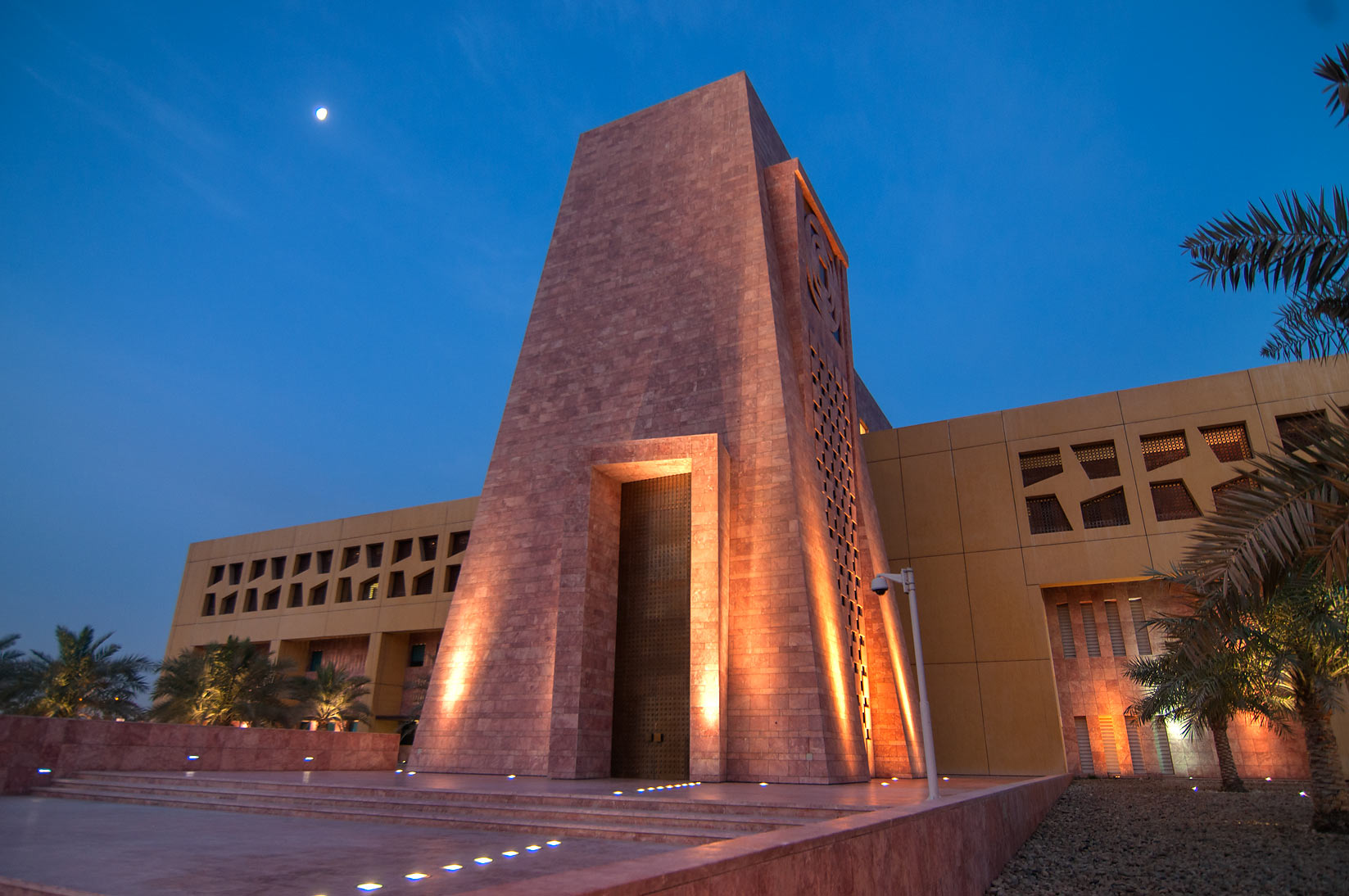 Main entrance of Texas A&M University in...Rayyan area, at evening. Doha, Qatar