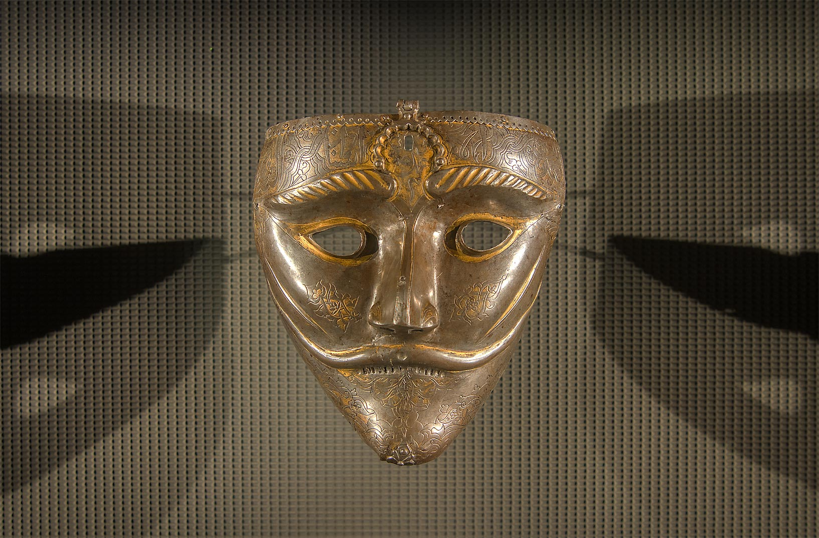 War mask (15th century, steel with gold inlay) in Museum of Islamic Art. Doha, Qatar