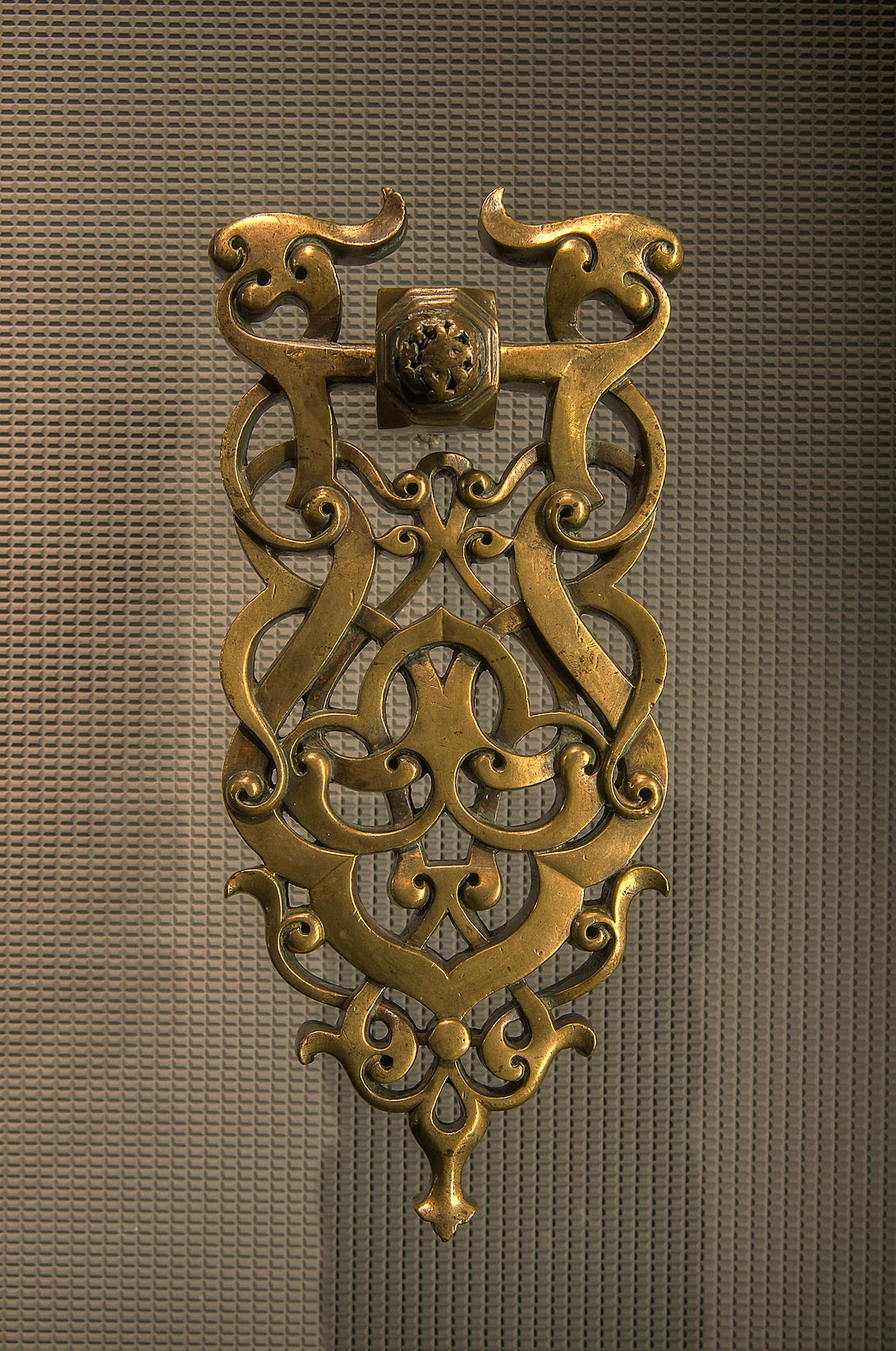 Door knocker (13th century, brass) in Museum of Islamic Art. Doha, Qatar