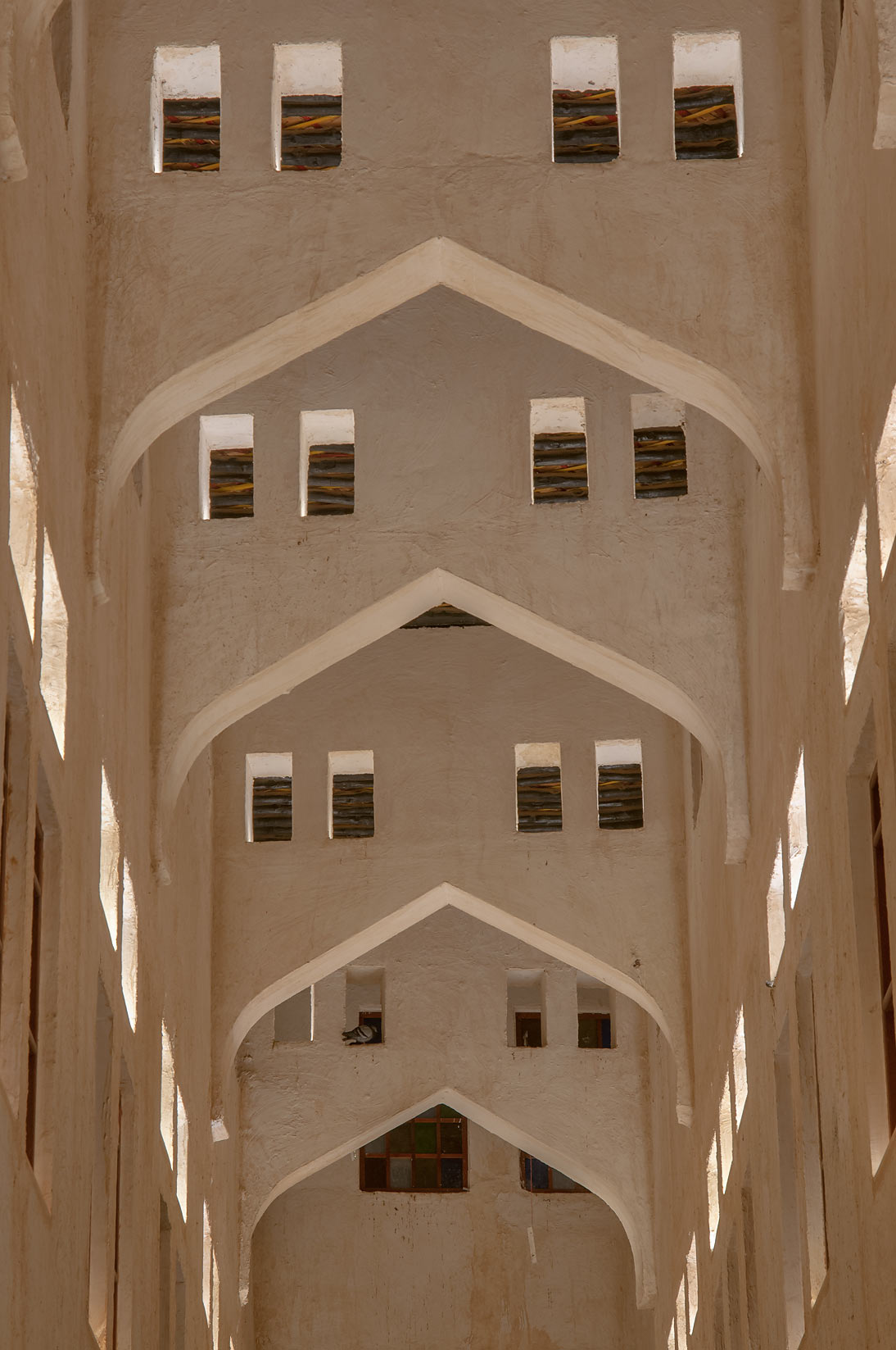 Arched gallery of Bird Market (falcons) in Souq Jaidah behind Souq Waqif. Doha, Qatar