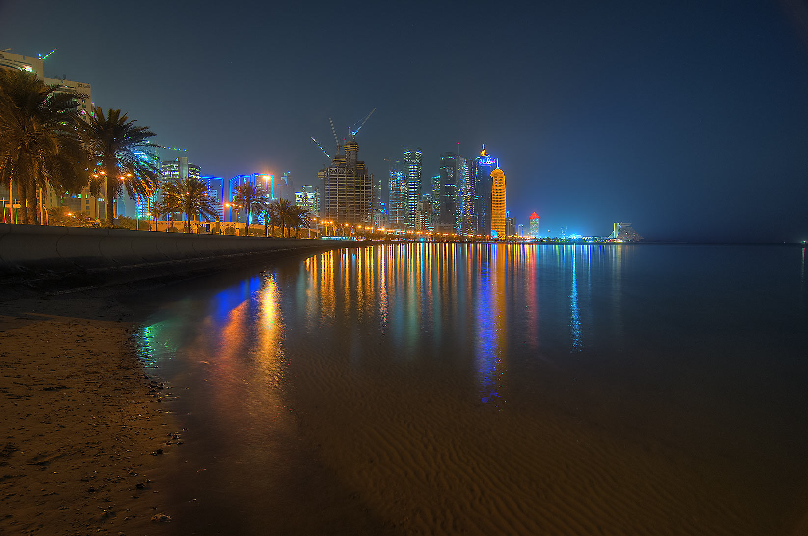 Lights of West Bay area from Corniche promenade. Doha, Qatar