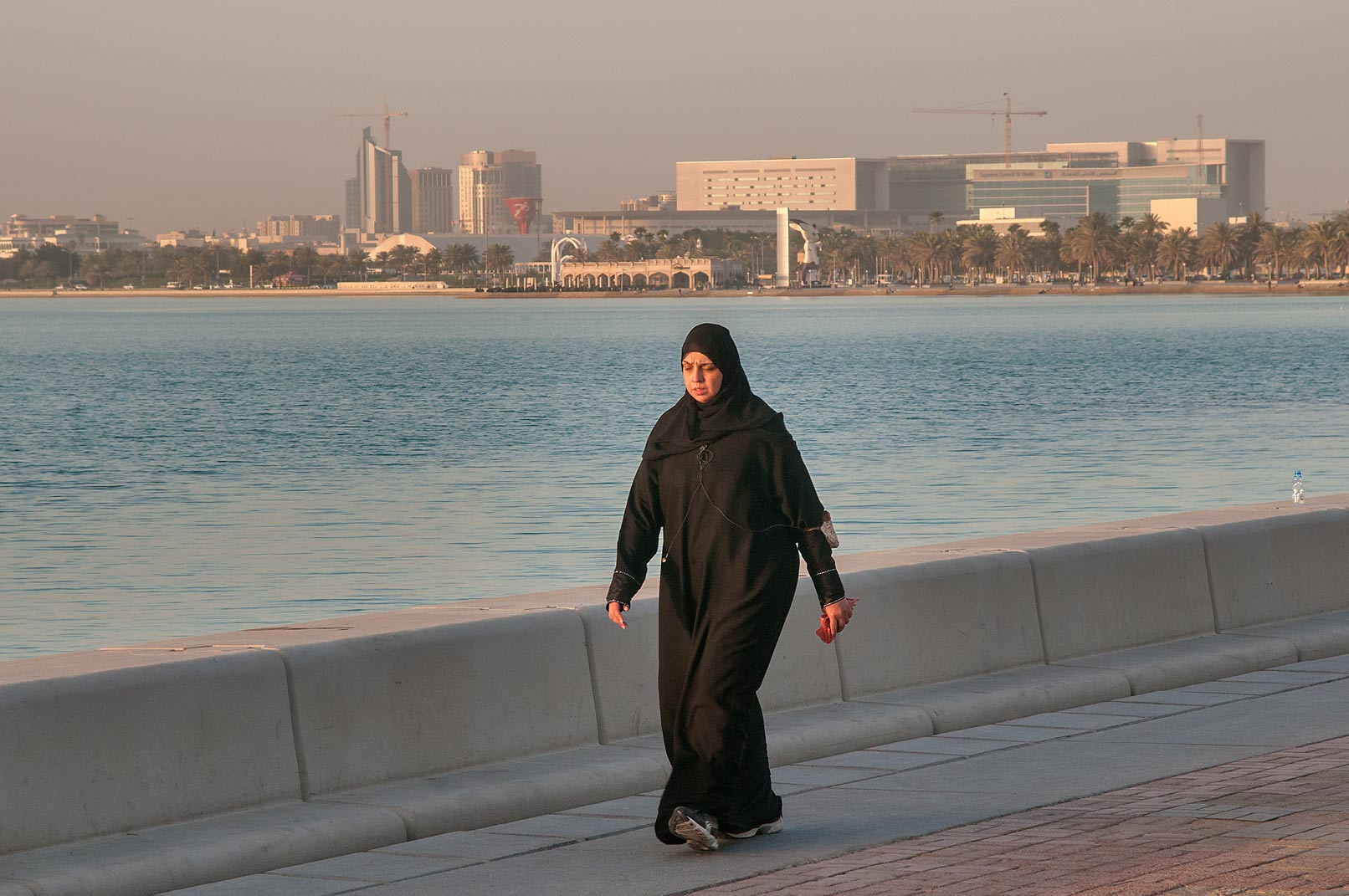 Jogging on Corniche promenade at morning. Doha, Qatar