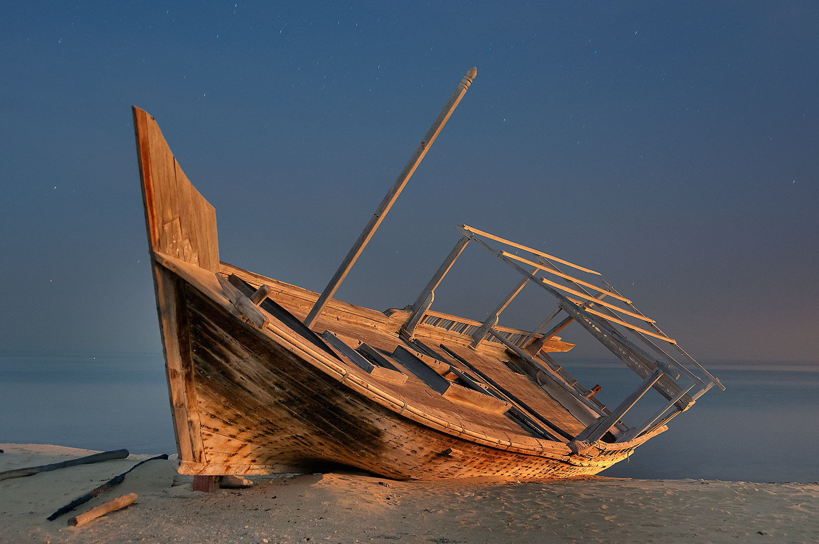 Dhow fishing boat on a beach in Al Wakra at morning. Qatar
