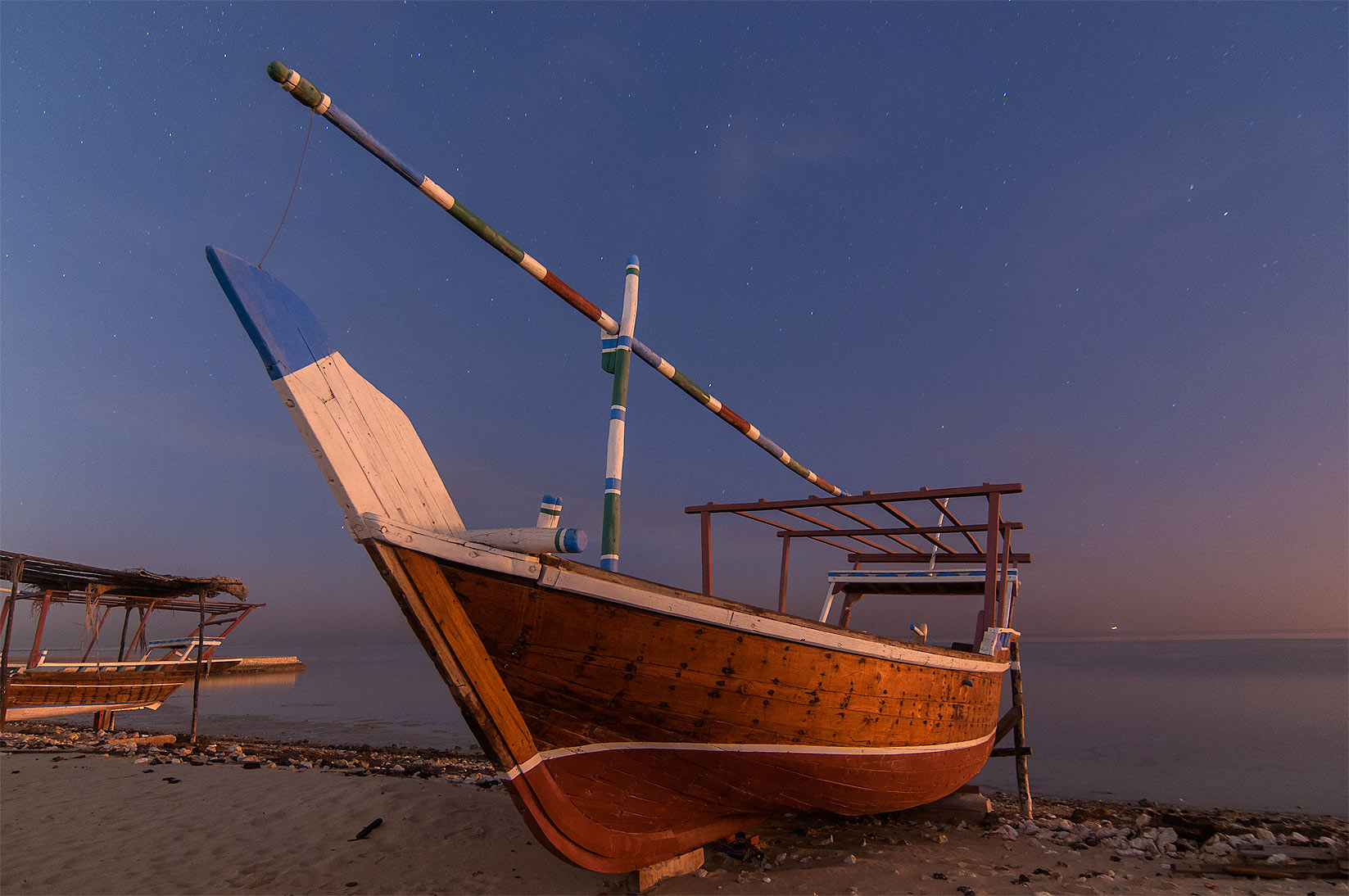 Small dhow fishing boat in Al Wakra at morning. Qatar
