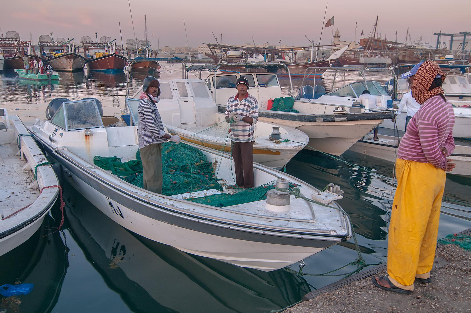 Fishermen in harbor in Al Wakra at morning. Qatar
