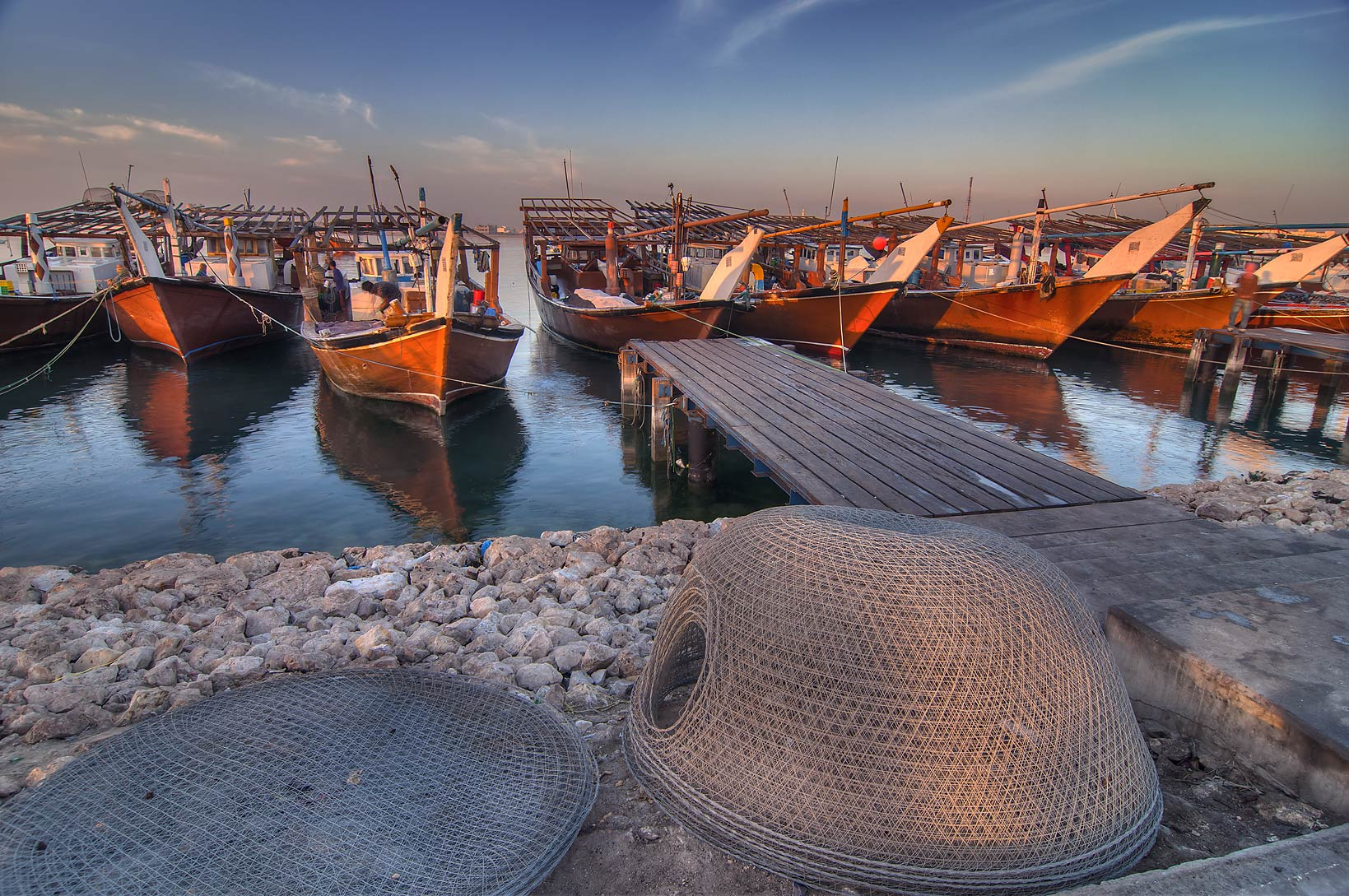 Dhow fishing boats in harbor in Al Wakra at sunrise. Qatar