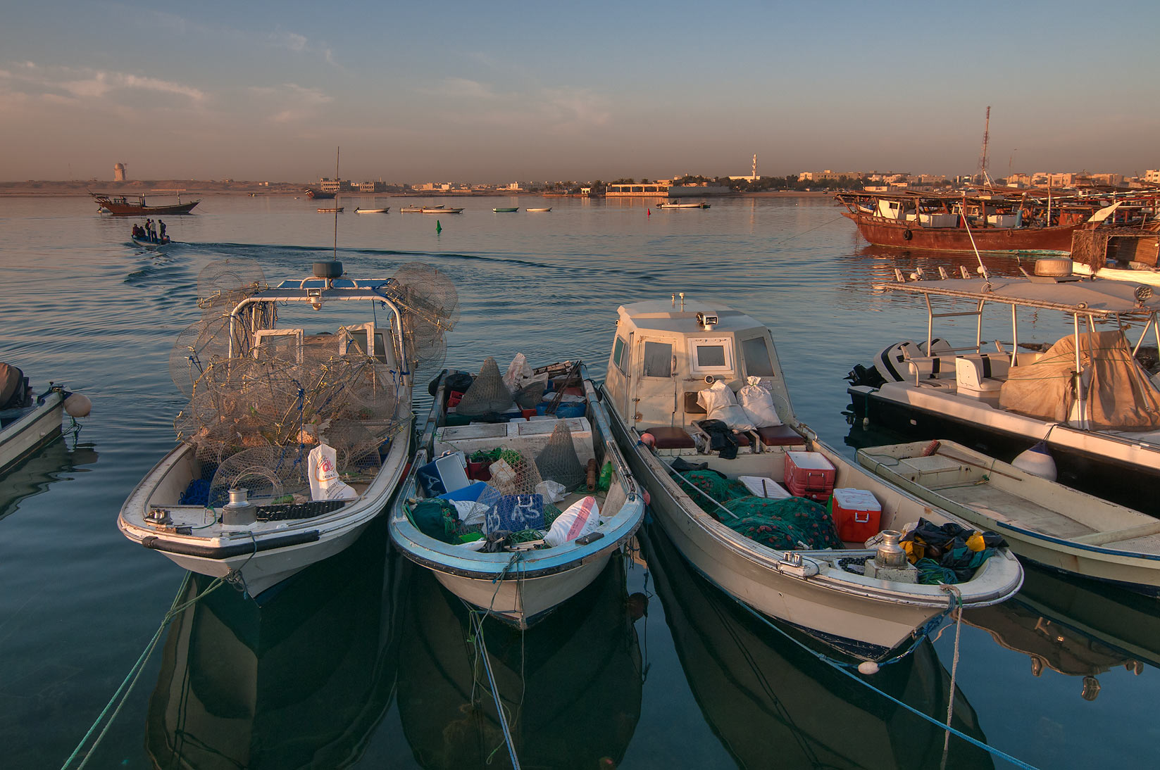 Fishing boats in harbor in Al Wakra at sunrise. Qatar