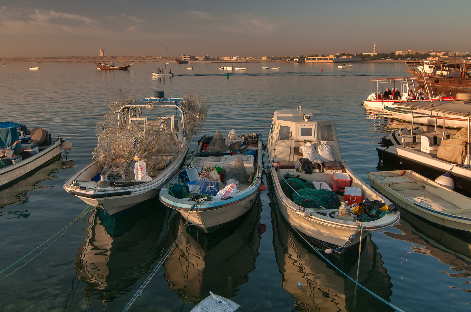 White fishing boats in harbor in Al Wakra. Qatar