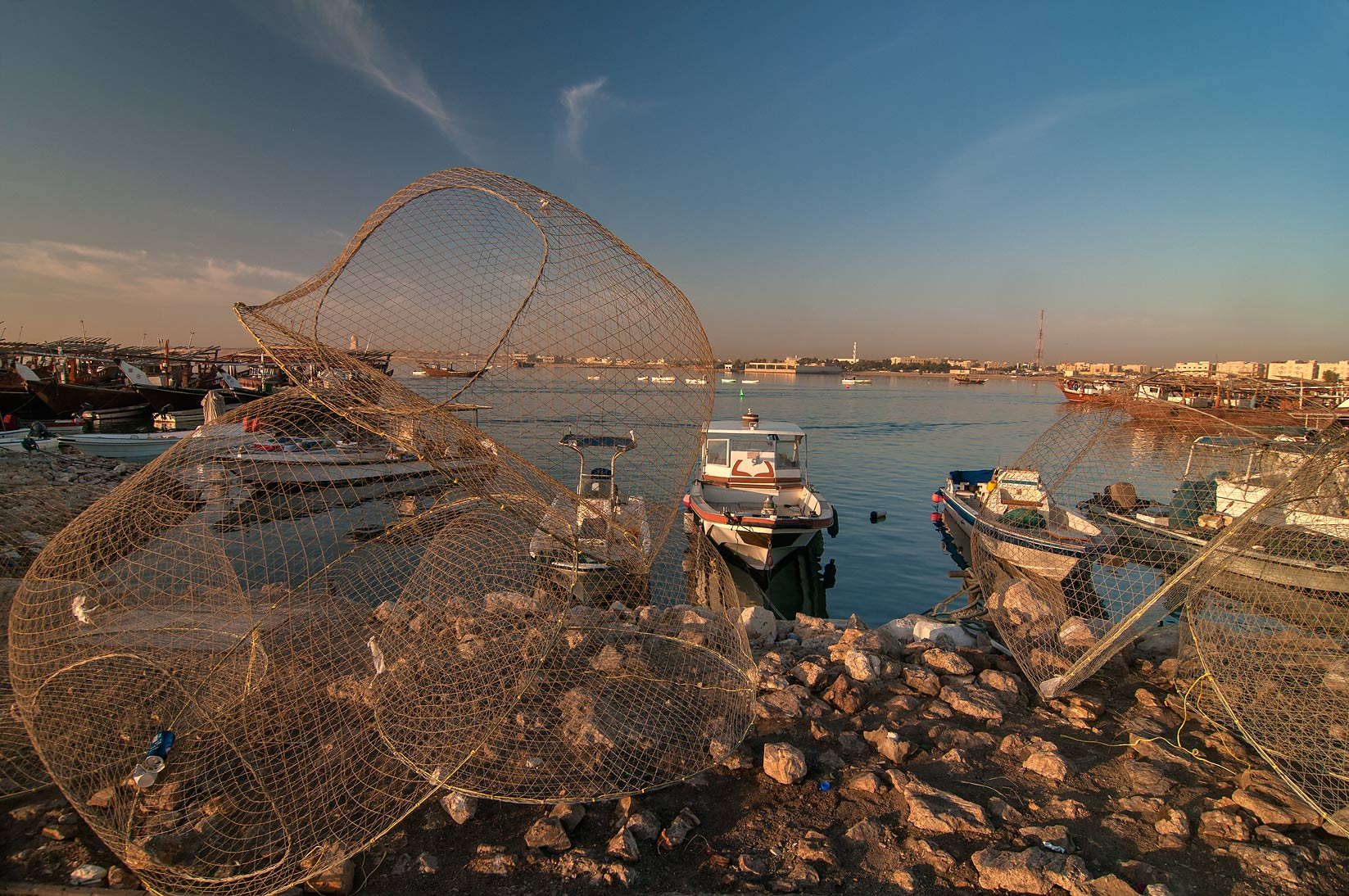 Domed wire fish traps (gargoor) on a pier in Al Wakra. Qatar