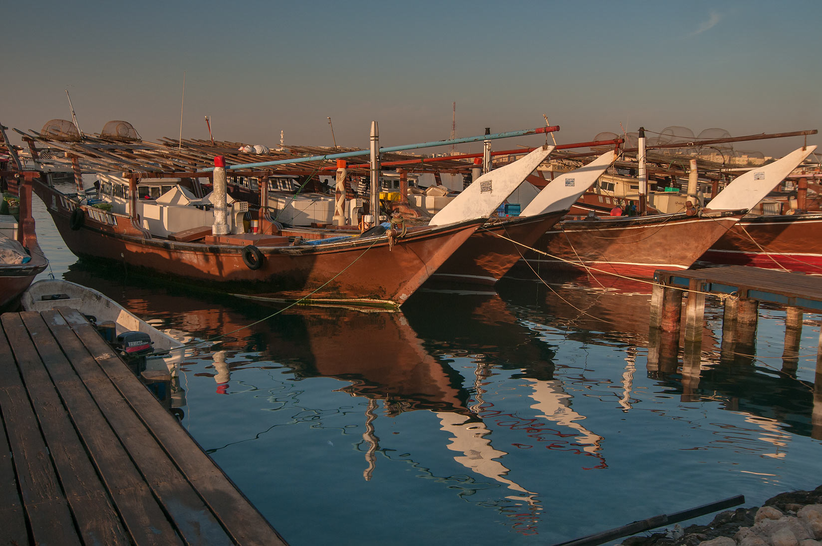 Wooden dhow fishing boats on a pier in Al Wakra. Qatar