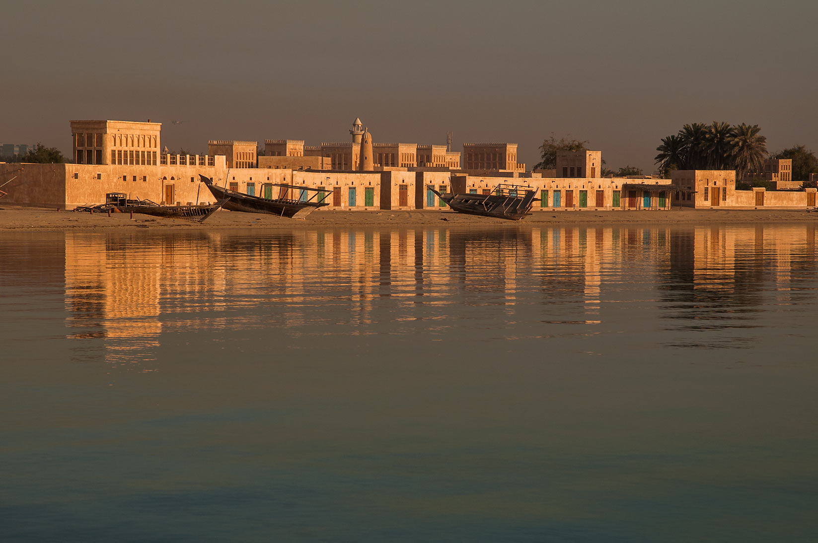 Restored historical village from a pier in Al Wakra at sunrise. Qatar