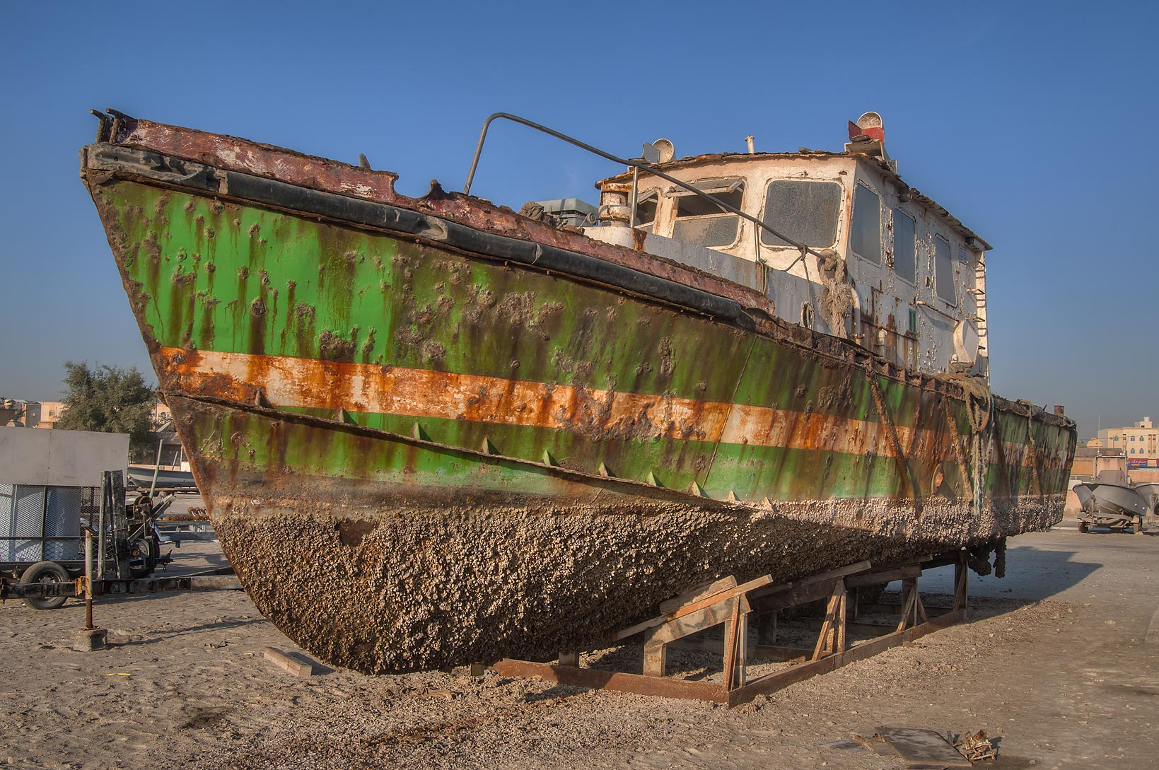 Old iron fishing boat in a shipyard in Al Wakra Qatar
