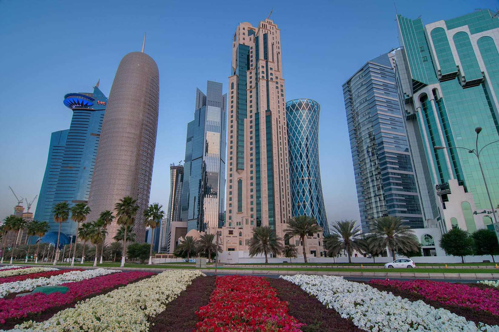 West Bay towers from a flower bed near tea pot...promenade at morning. Doha, Qatar