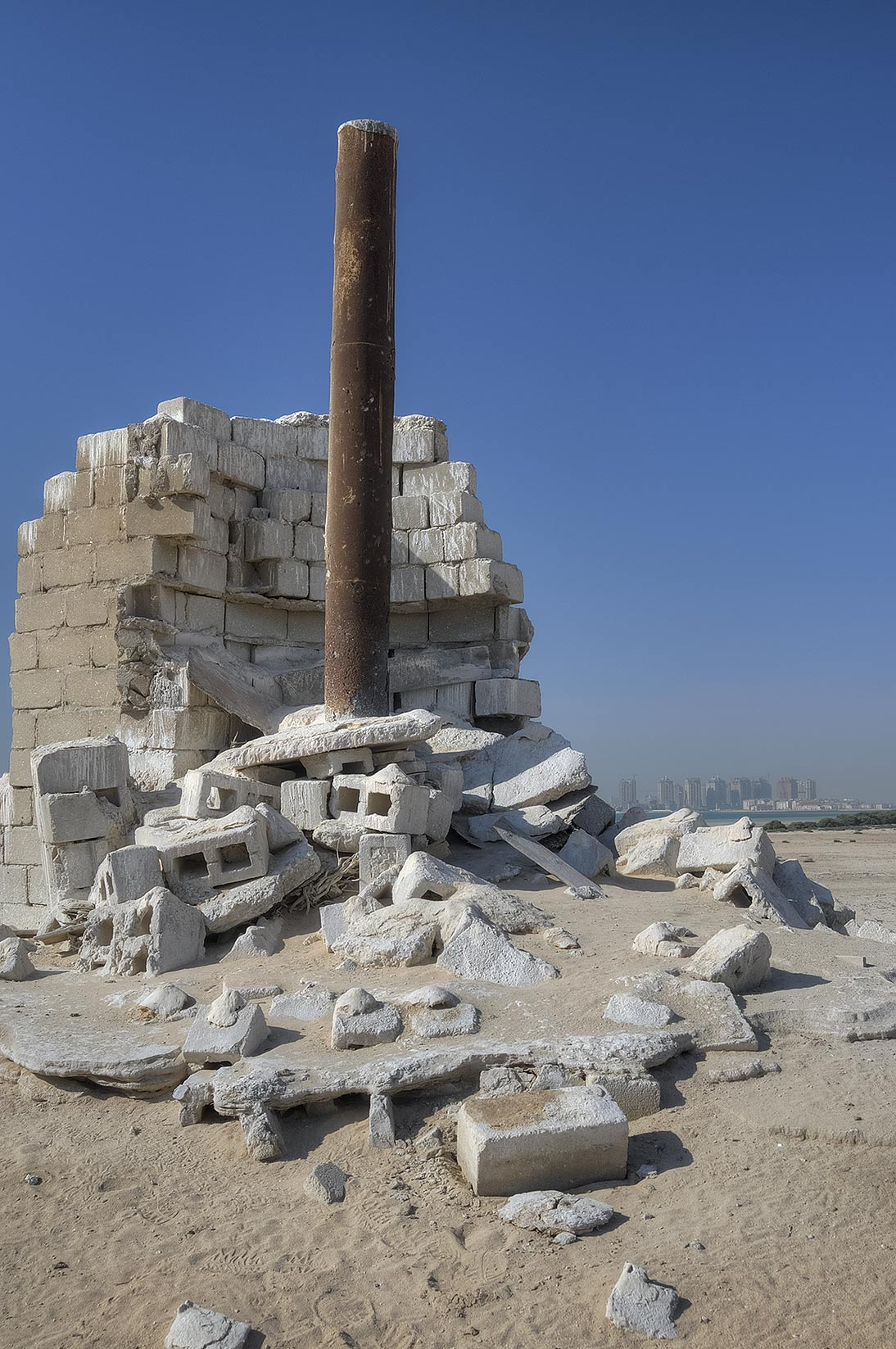 Ruins of chimney made from cinder blocks in Al Aaliya Island (Jazirat al Aliyah). Qatar