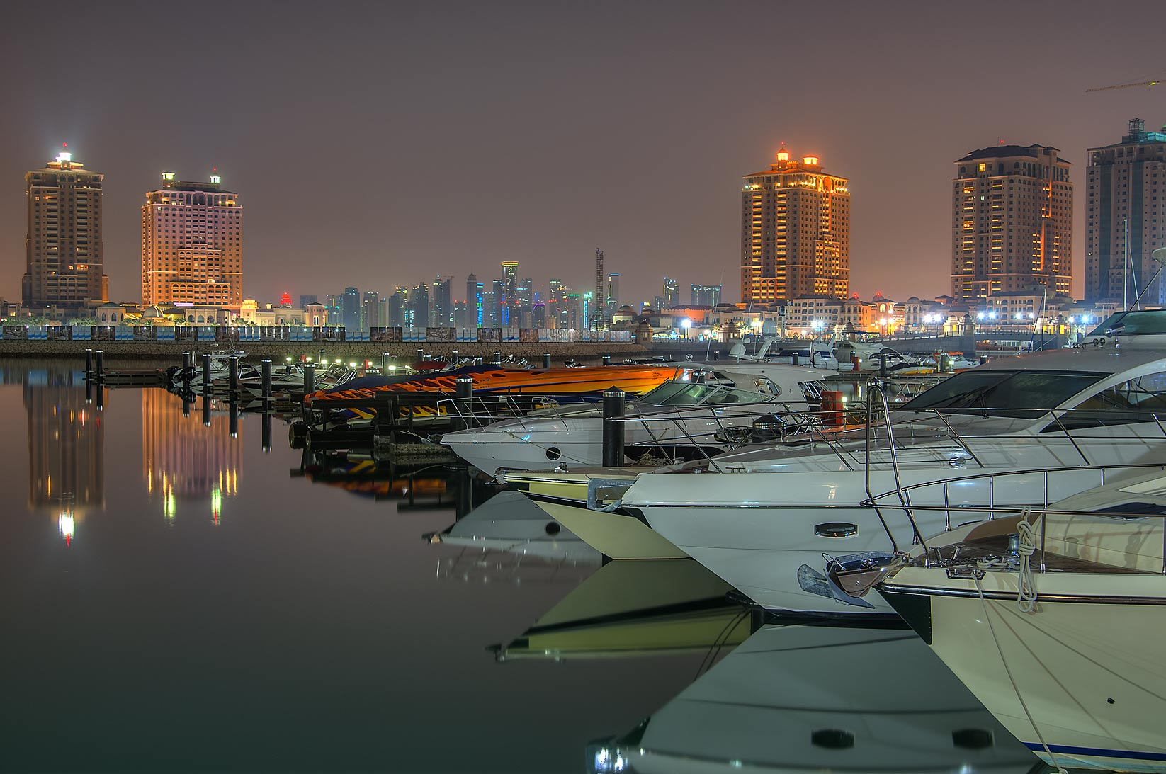 Boats in marina of Porto Arabia in Pearl Qatar Development at early morning. Doha, Qatar
