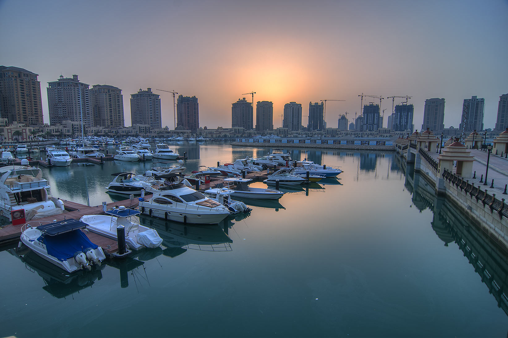 Marina in Porto Arabia in Pearl Qatar Development at sunrise. Doha, Qatar