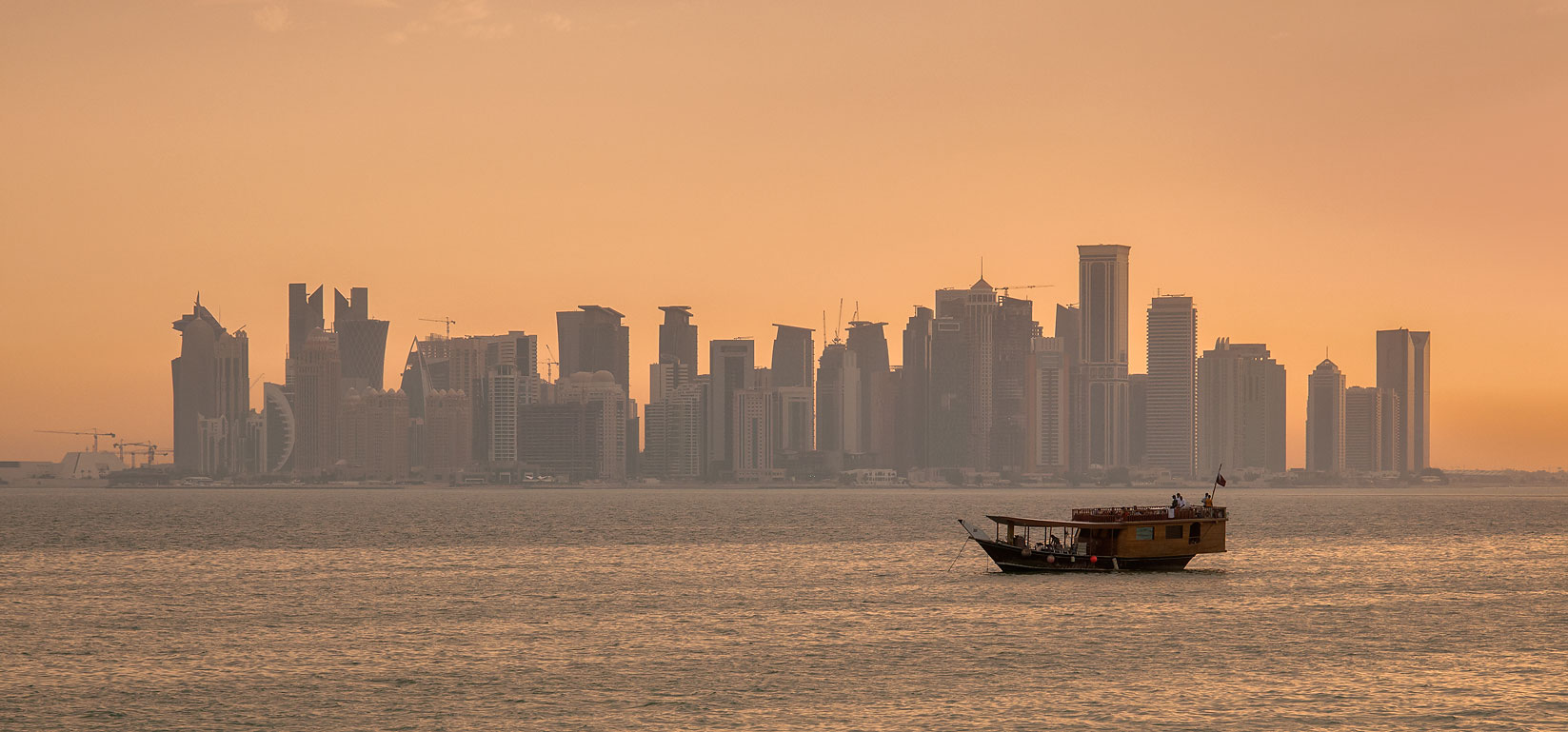 View of West Bay from Safliya Island near Doha at sunset. Qatar