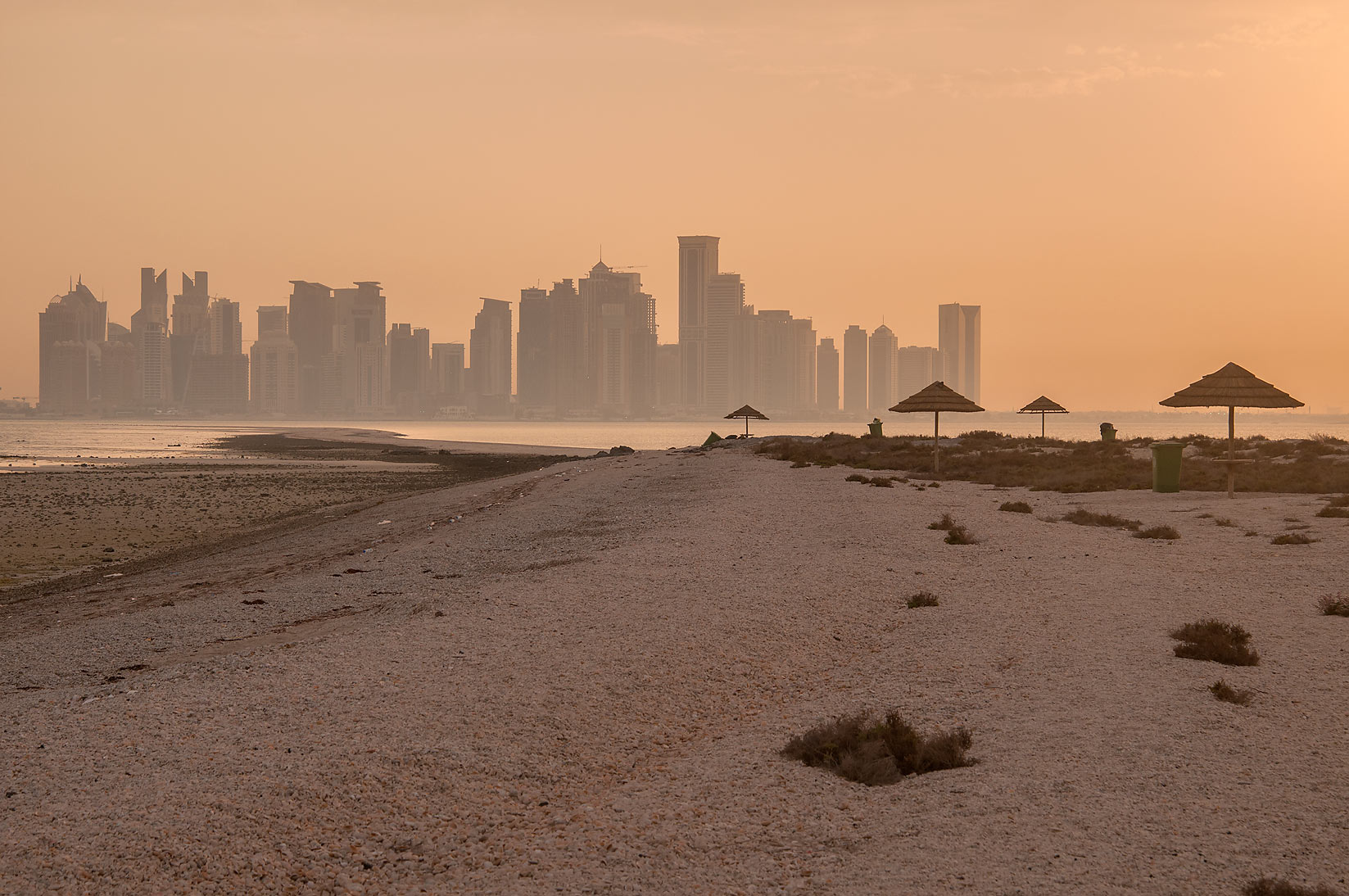 Sand spit of Safliya Island near Doha at sunset, with West Bay in background. Qatar