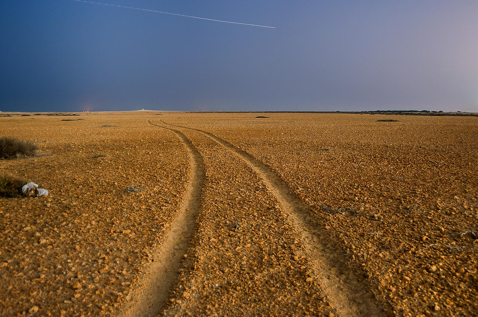 Car tracks in Al Aaliya Island near Doha at evening. Qatar