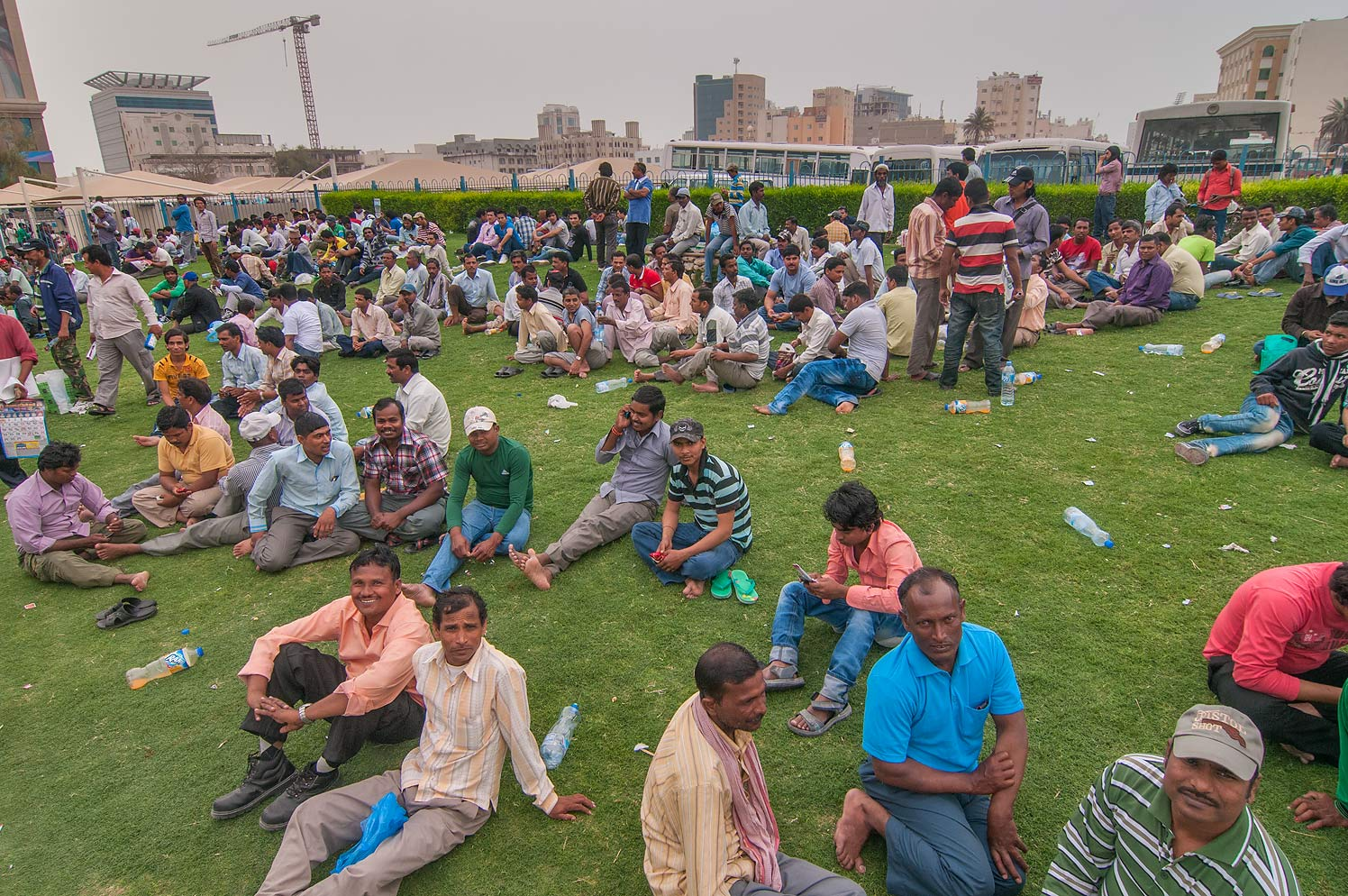 Crowds of migrant workers gathering near Central Bus Station Al Ghanim. Doha, Qatar