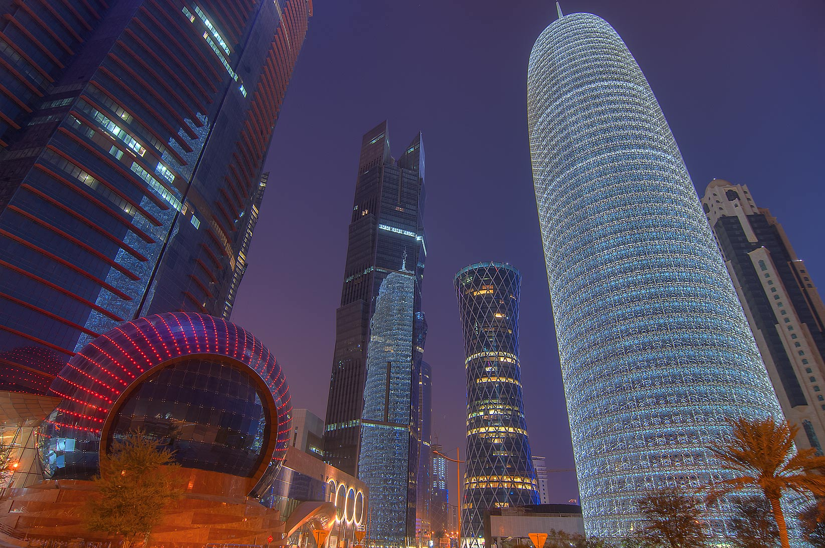 Glowing WTC and Burj Qatar Tower in West Bay from Corniche promenade. Doha, Qatar