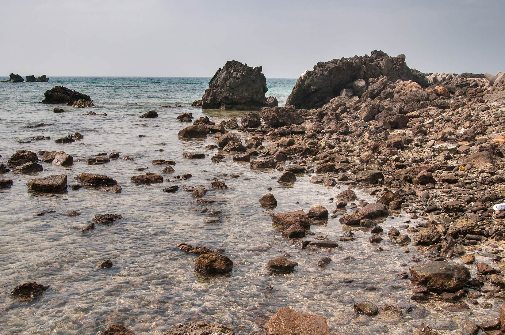 Rocky shore of Persian Gulf in western part of Haloul Island (Jazirat Halul). Qatar
