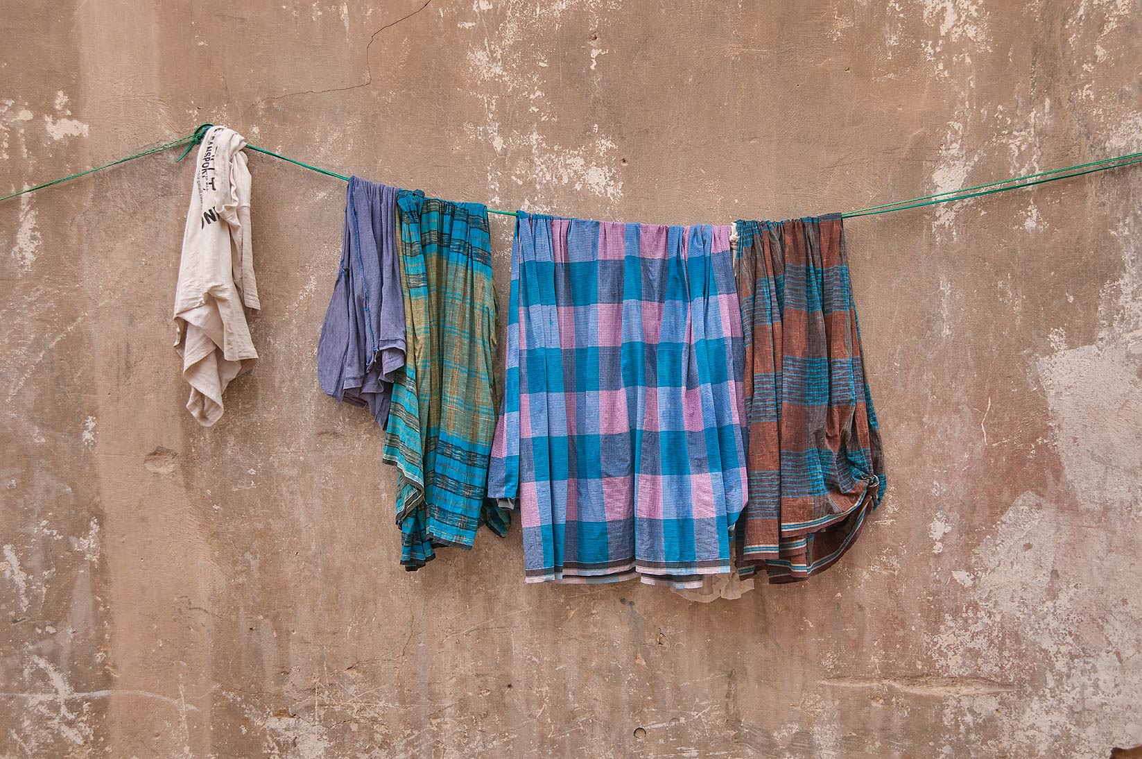 Hanging laundry at Al Jassasiya St. at rain, Musheirib area. Doha, Qatar