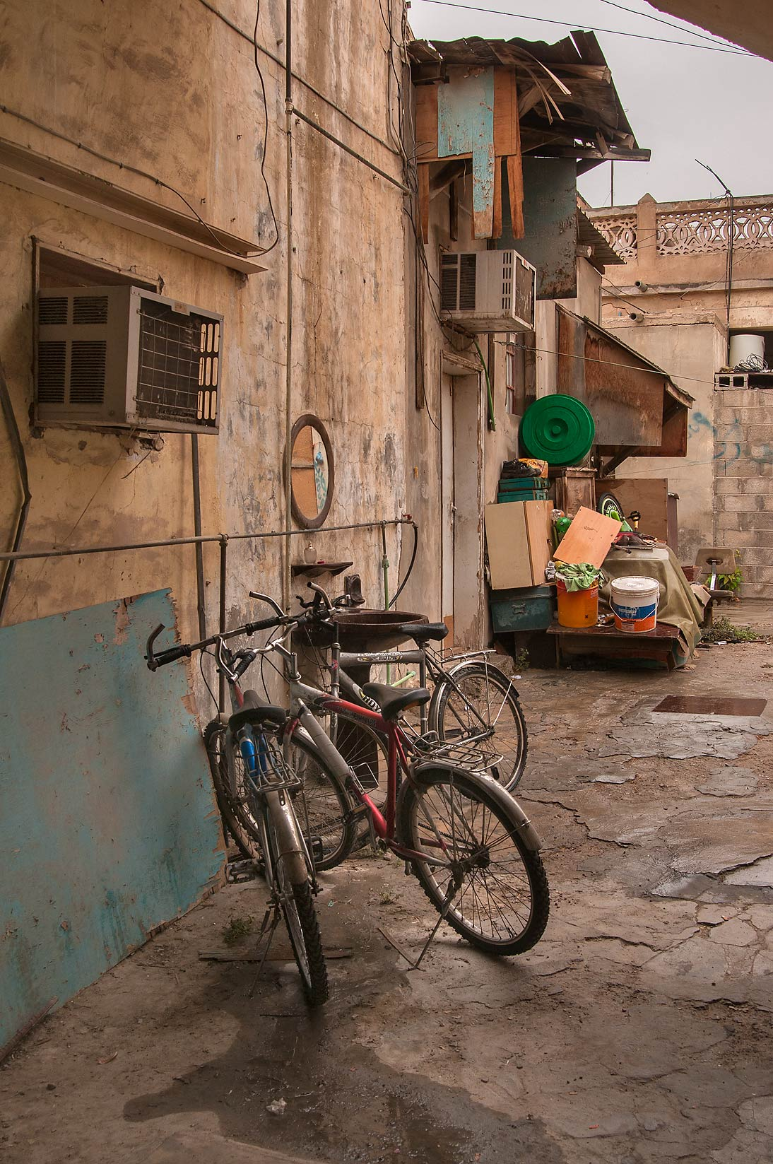 Courtyard with bicycles on Umm Wishah St., Musheirib area. Doha, Qatar