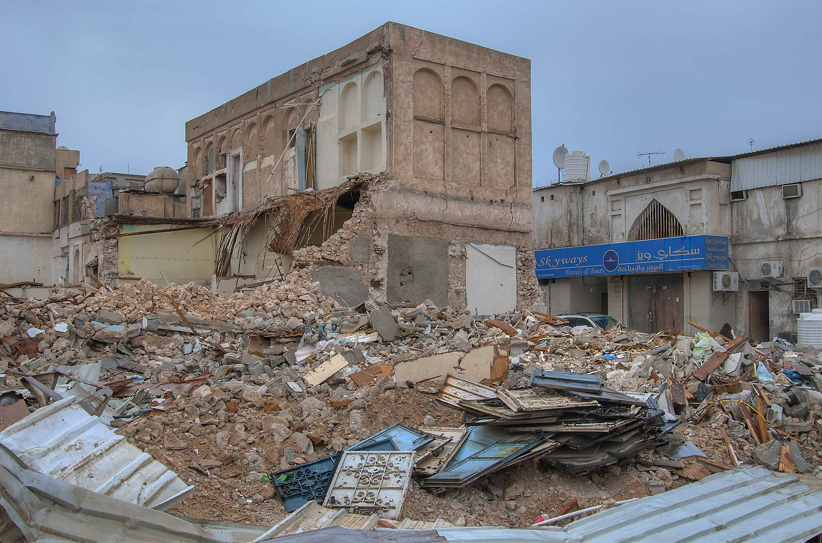 Rubble at a corner of Al Maymoun and Al Hasan Bin Ali streets, Musheirib area. Doha, Qatar