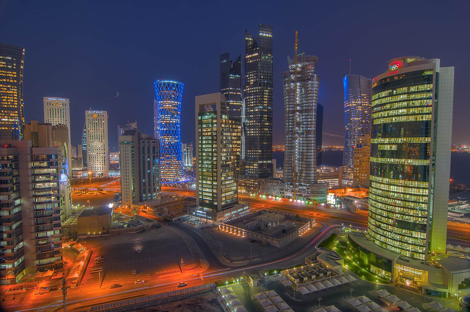 Lights of West Bay, view to the east from a...Dareen Tower at evening. Doha, Qatar