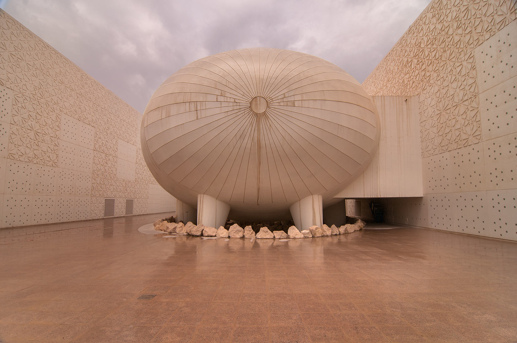 Ovoid lecture hall of Weill Cornell Medical College in Education City at rain. Doha, Qatar