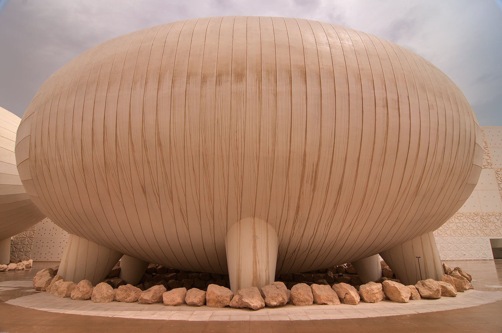 Giant insect egg like ovoid lecture hall of Weill...in Education City at rain. Doha, Qatar