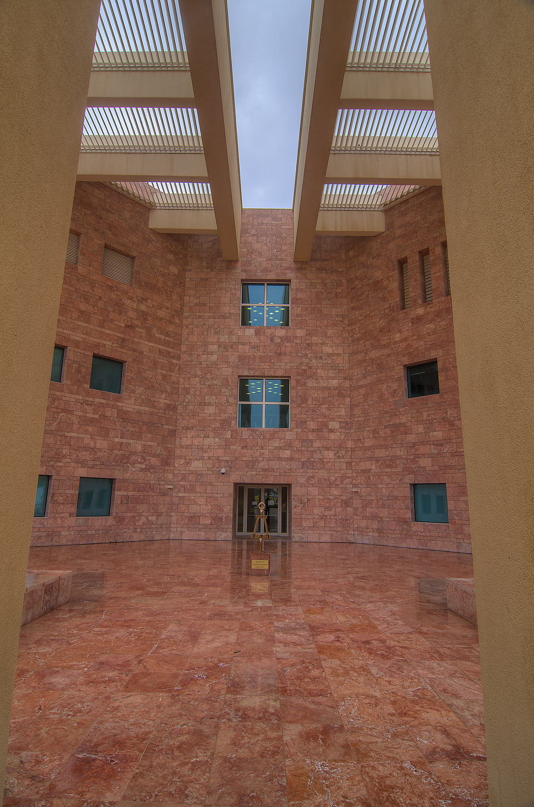 Shaded entrance of research rotunda of Texas A...in Education City at rain. Doha, Qatar
