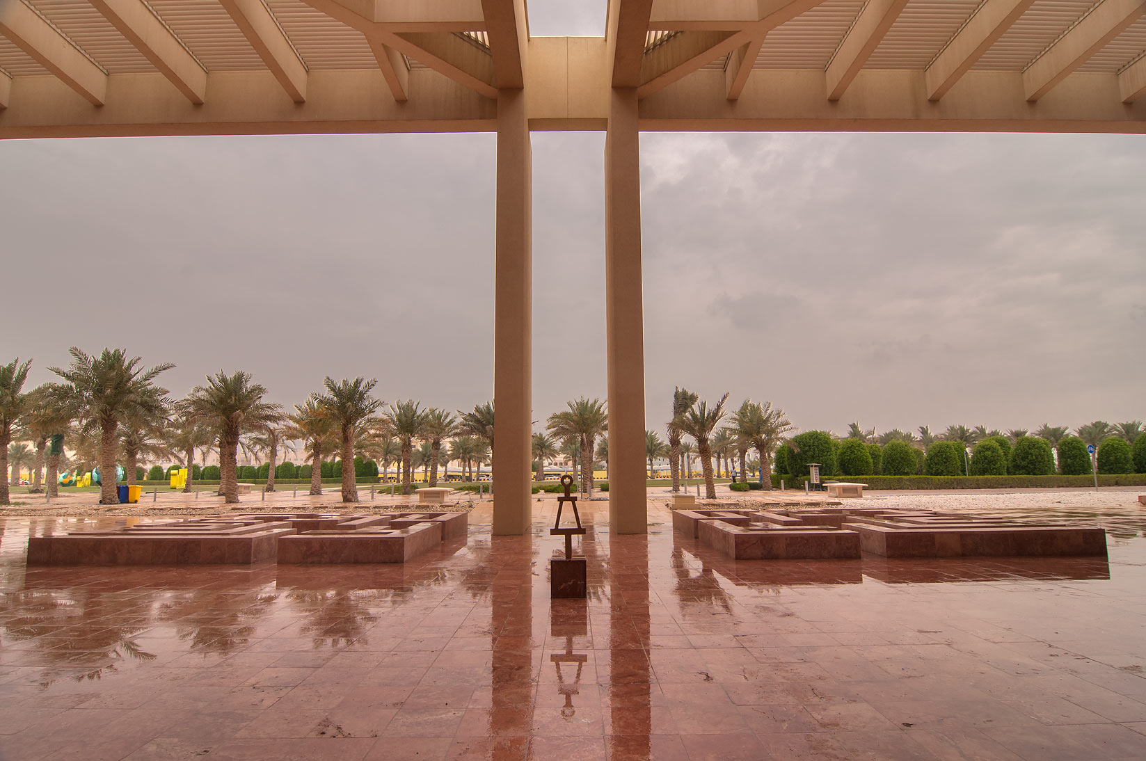 View from shaded entrance of research rotunda of...in Education City at rain. Doha, Qatar