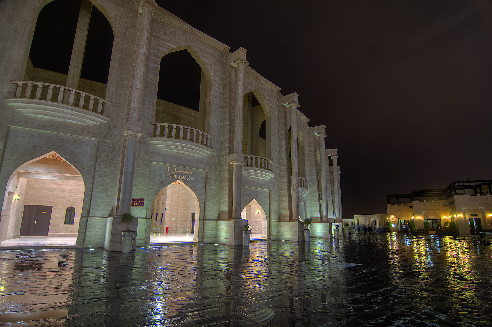 Lights of amphitheatre in Katara Cultural Village at rain. Doha, Qatar
