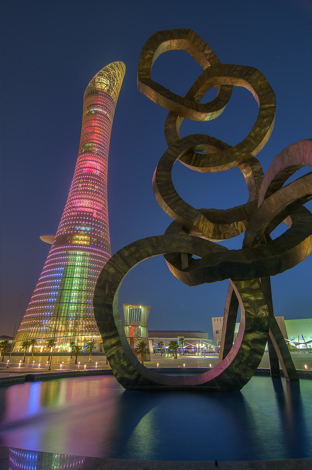 Torch Hotel and Olympic rings sculpture in Aspire Zone at evening. Doha, Qatar