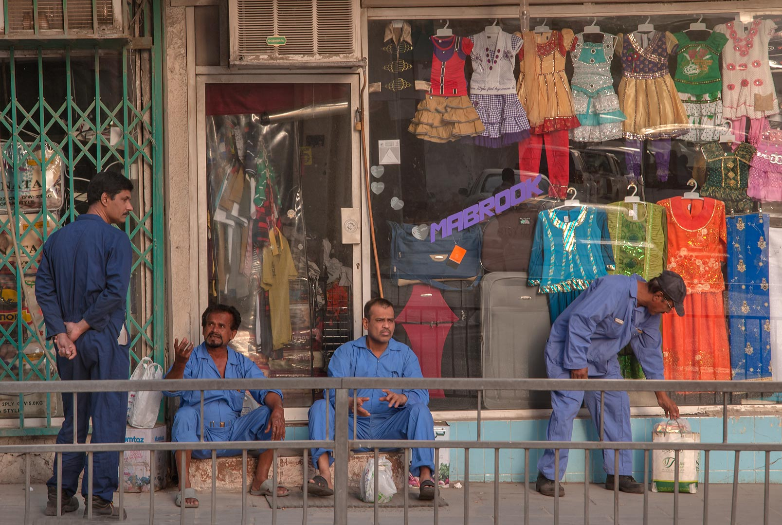 Workers in front of Mabrook children's store at...Thani St., Musheirib area. Doha, Qatar