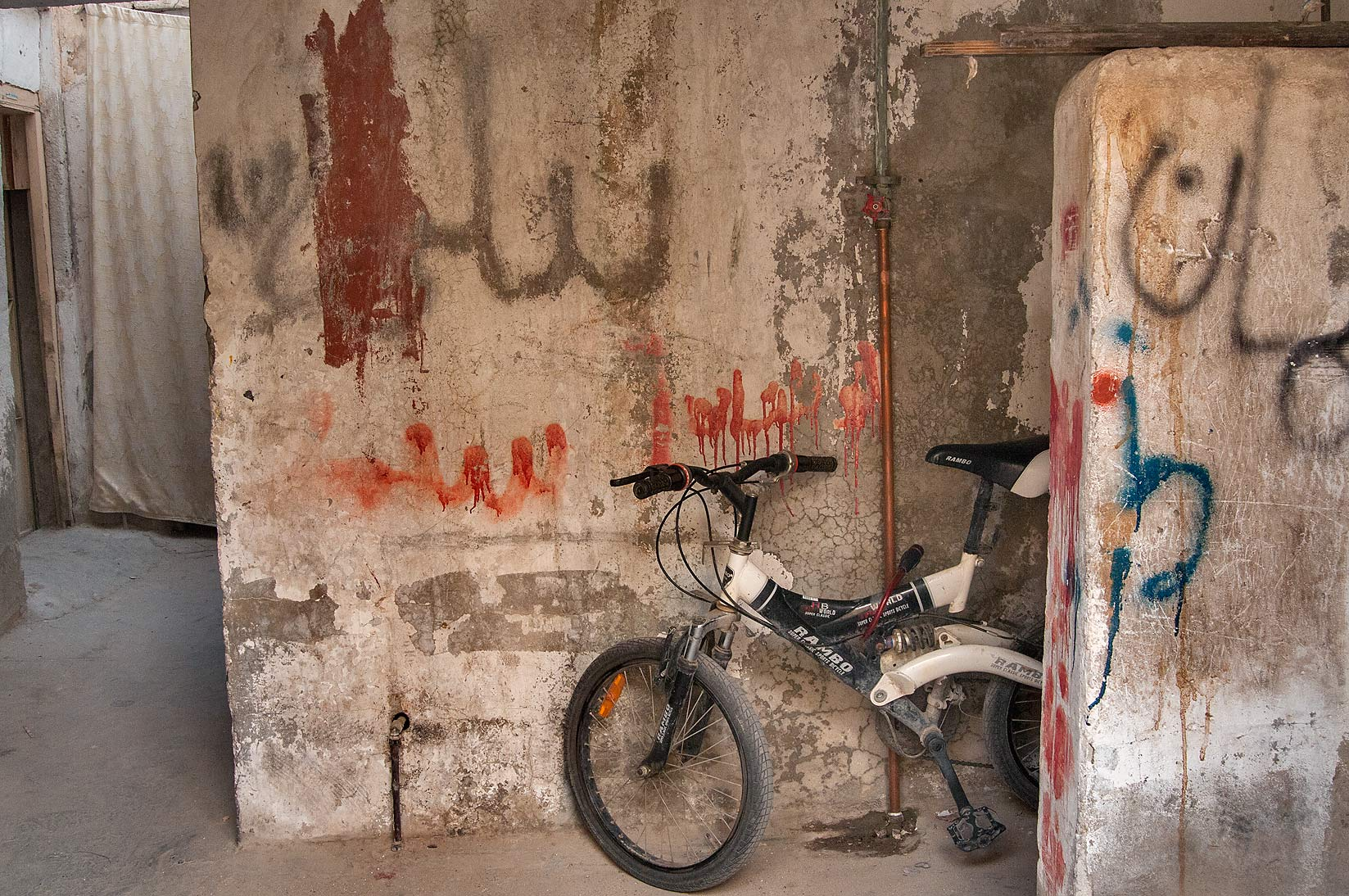 Bicycle parked in worker's apartment near Al Jassasiya St., Musheirib area. Doha, Qatar