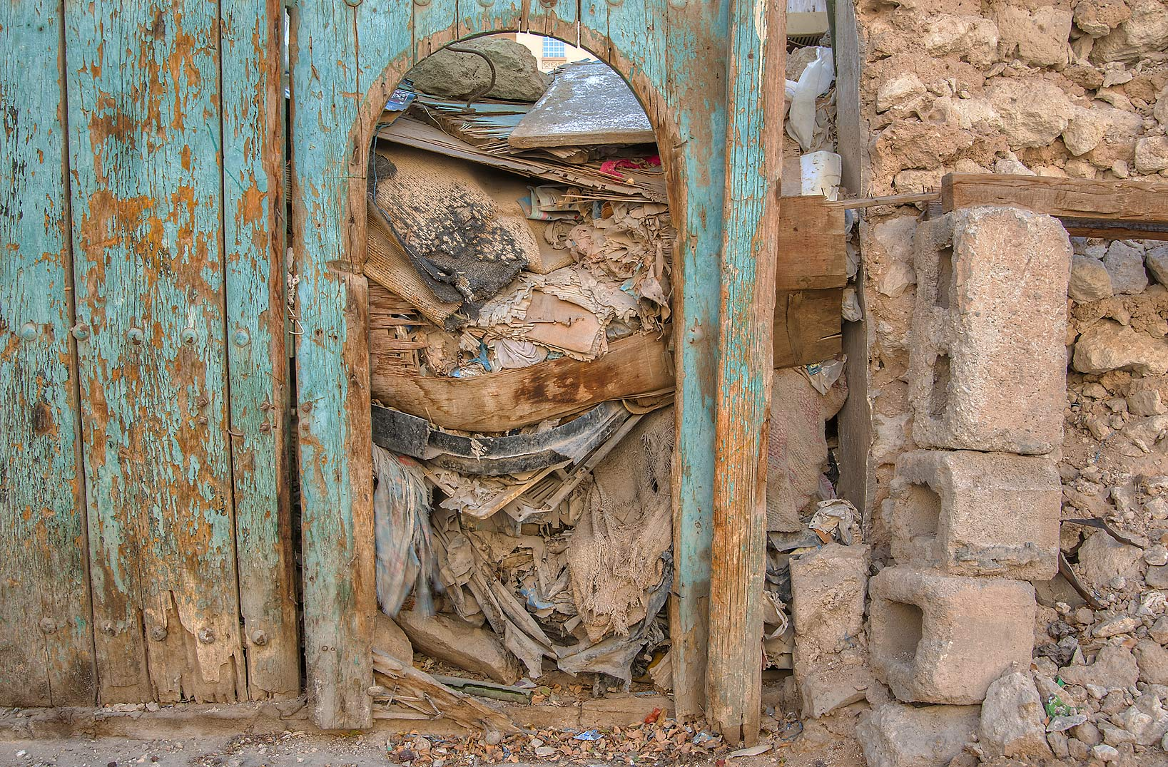 Littered entrance of an old house at Ibn Al...Fereej Abdel Aziz area. Doha, Qatar