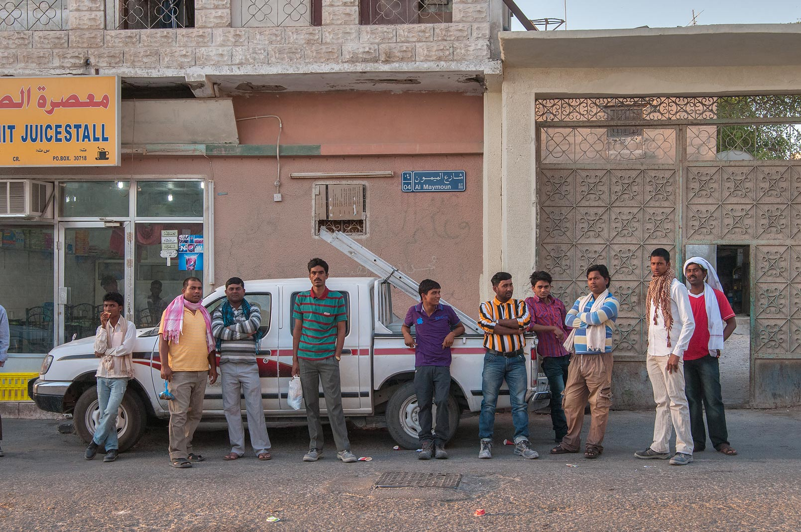 People gathering near Al Samit Jucestall on Al Maymoun St., Musheirib area. Doha, Qatar