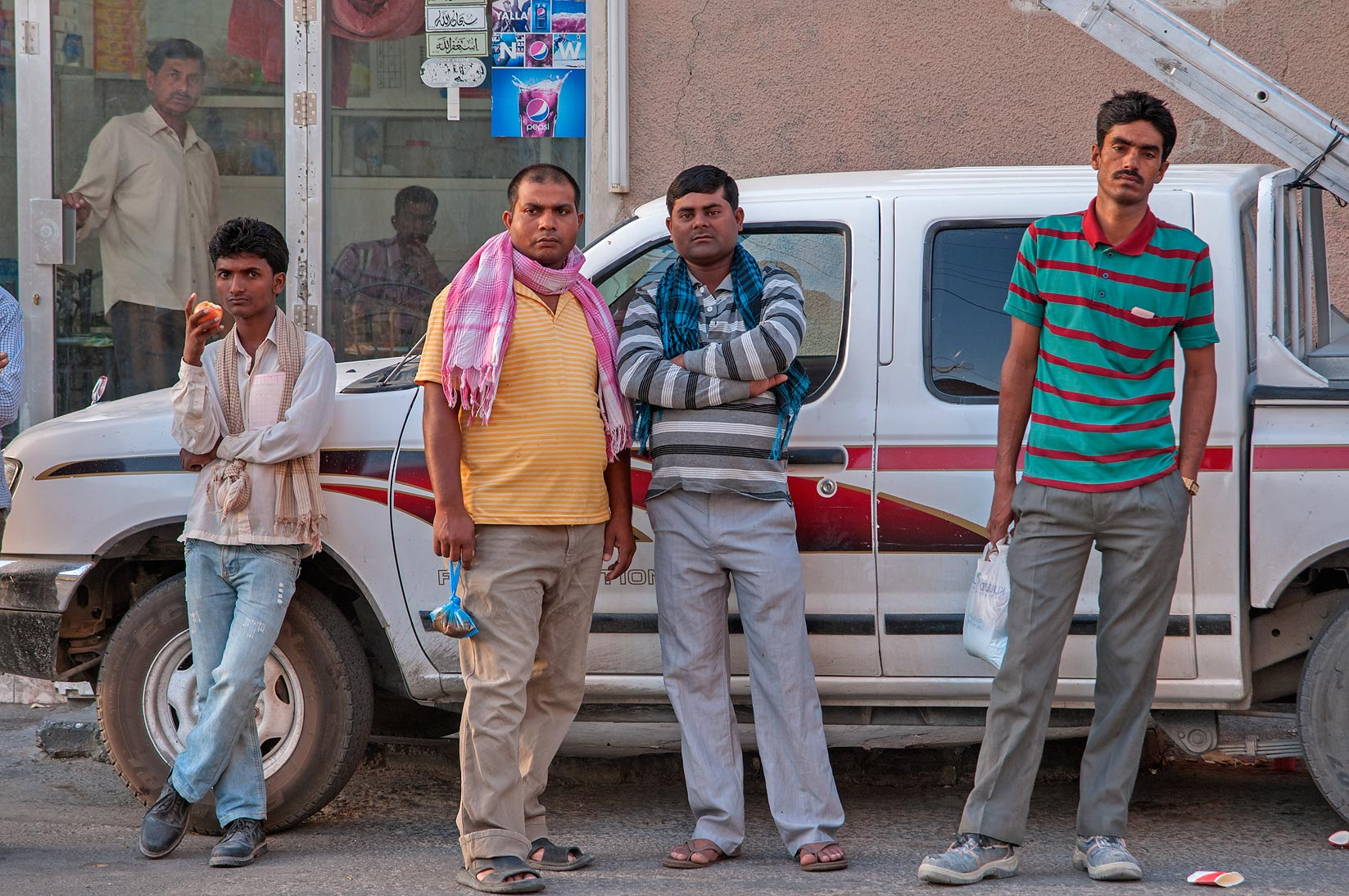 People standing near Al Samit Jucestall on Al Maymoun St., Musheirib area. Doha, Qatar