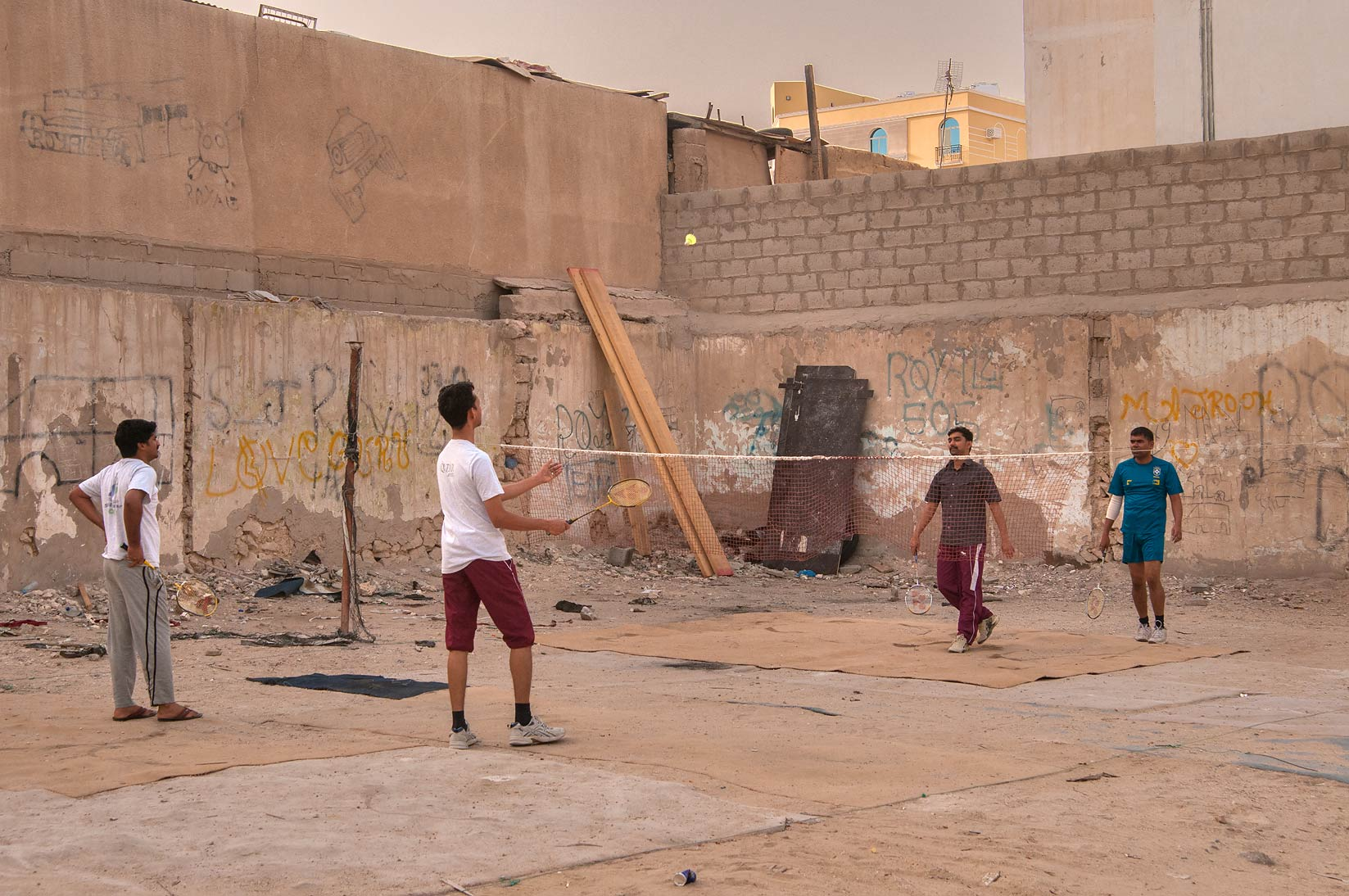 Playing badminton at Ibn Abdul Salam St., a...Al Doha Al Jadeeda area. Doha, Qatar