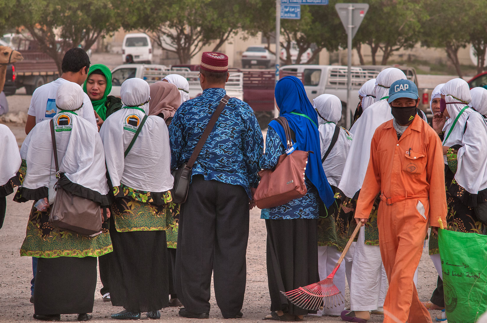 Tourists from Indonesia taking pictures in front...Market, Abu Hamour area. Doha, Qatar