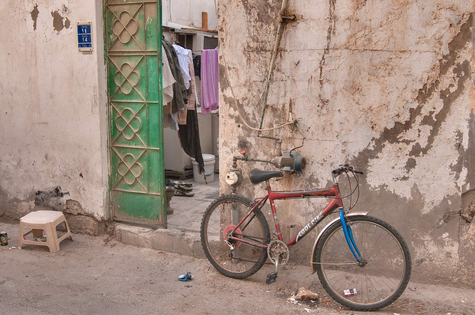 Worker's bicycle parked near apartment at Sikkat...Mansoura St., Najma area. Doha, Qatar