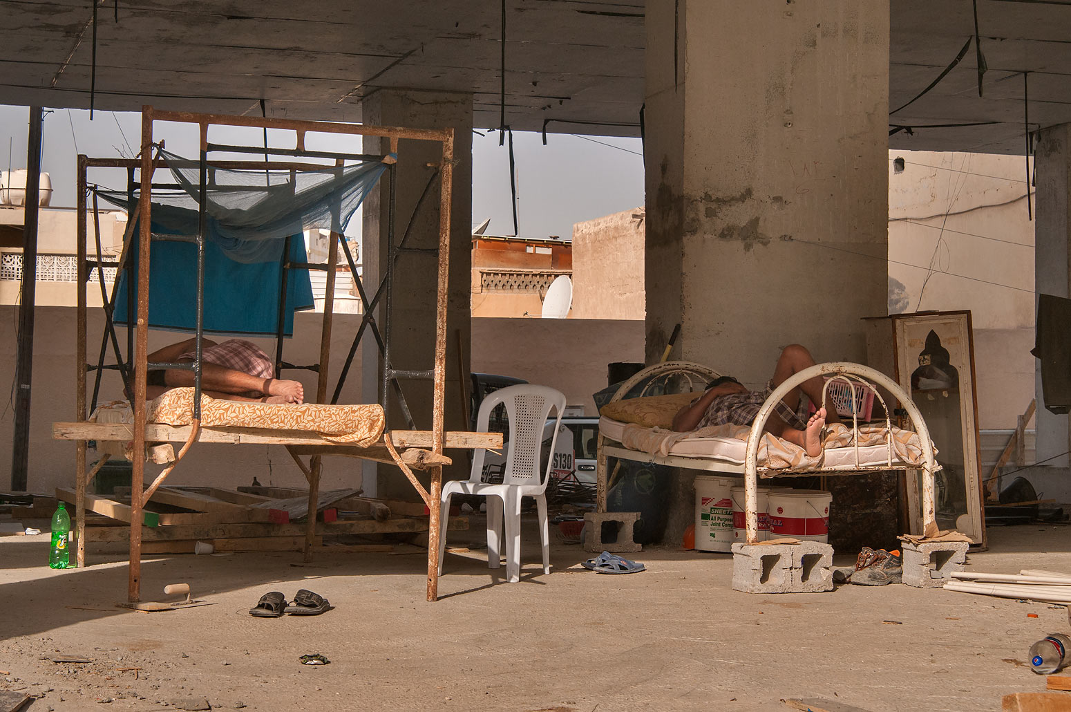 Workers sleeping in a temporary accommodation in...Dawakhil St., Najma area. Doha, Qatar