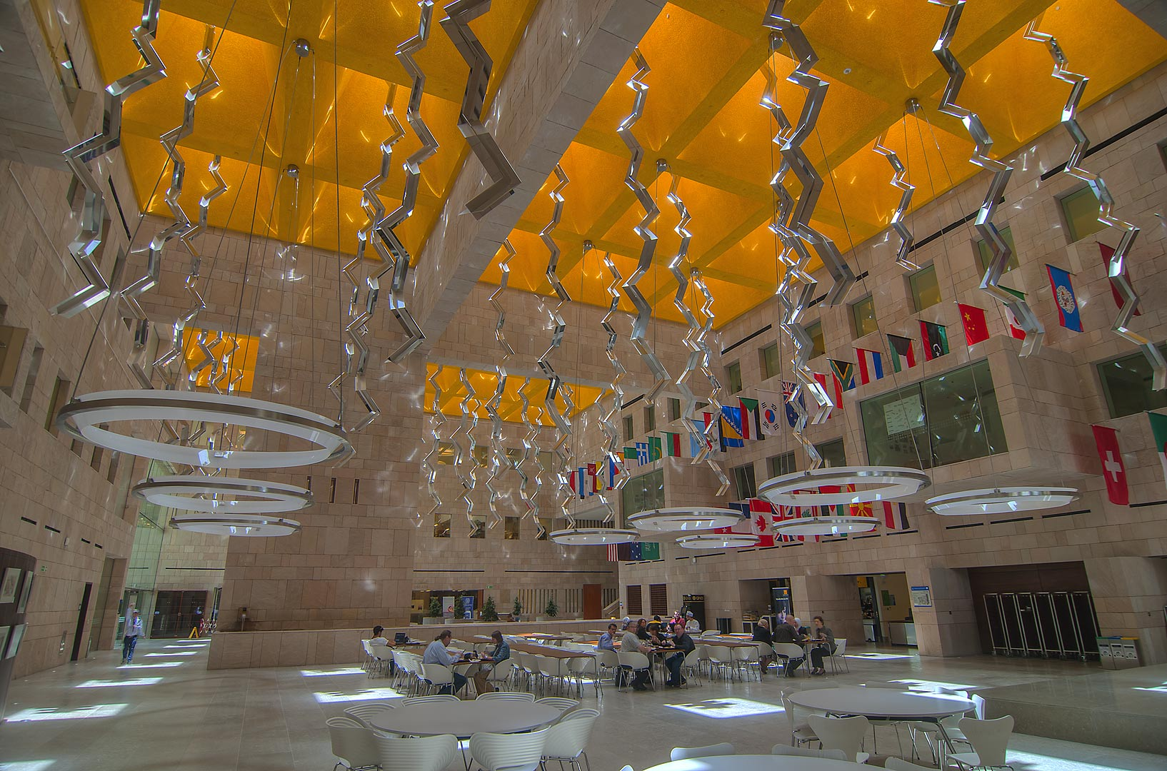Atrium with flags in Georgetown University in...Regazzoni Sculpture. Doha, Qatar
