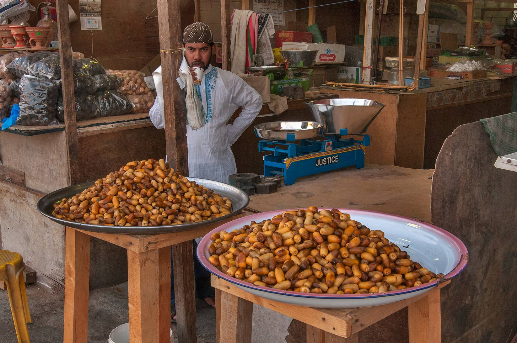 Vendor with dates in Omani Market, Abu Hamour area. Doha, Qatar