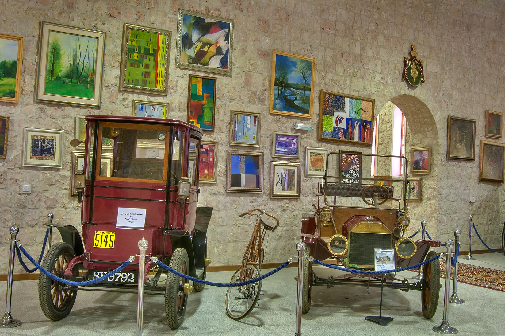 Classic cars and bicycles with modern art in...Museum near Al-Shahaniya. Doha, Qatar