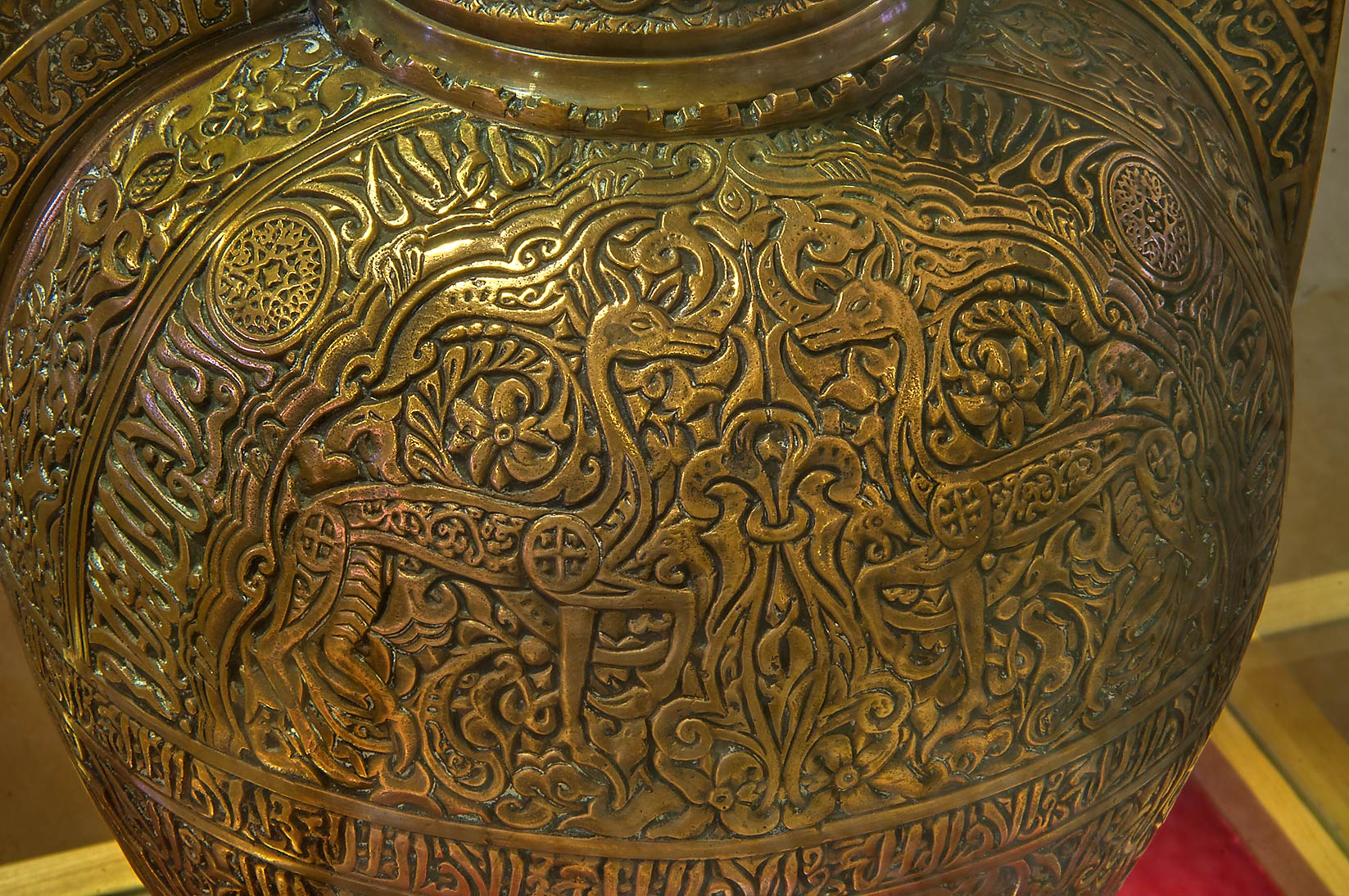 Fragment of decorated brass pot in Sheikh Faisal...Museum near Al-Shahaniya. Doha, Qatar